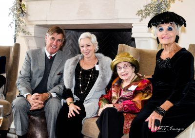 Silver Tea_Bill Davidson with ladies in front of fireplace